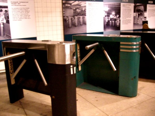 Three horizontally oriented metal turnstiles on display at the New York Transit Museum. Photo by Allison Meier, aka Astrozombie, on Flickr.