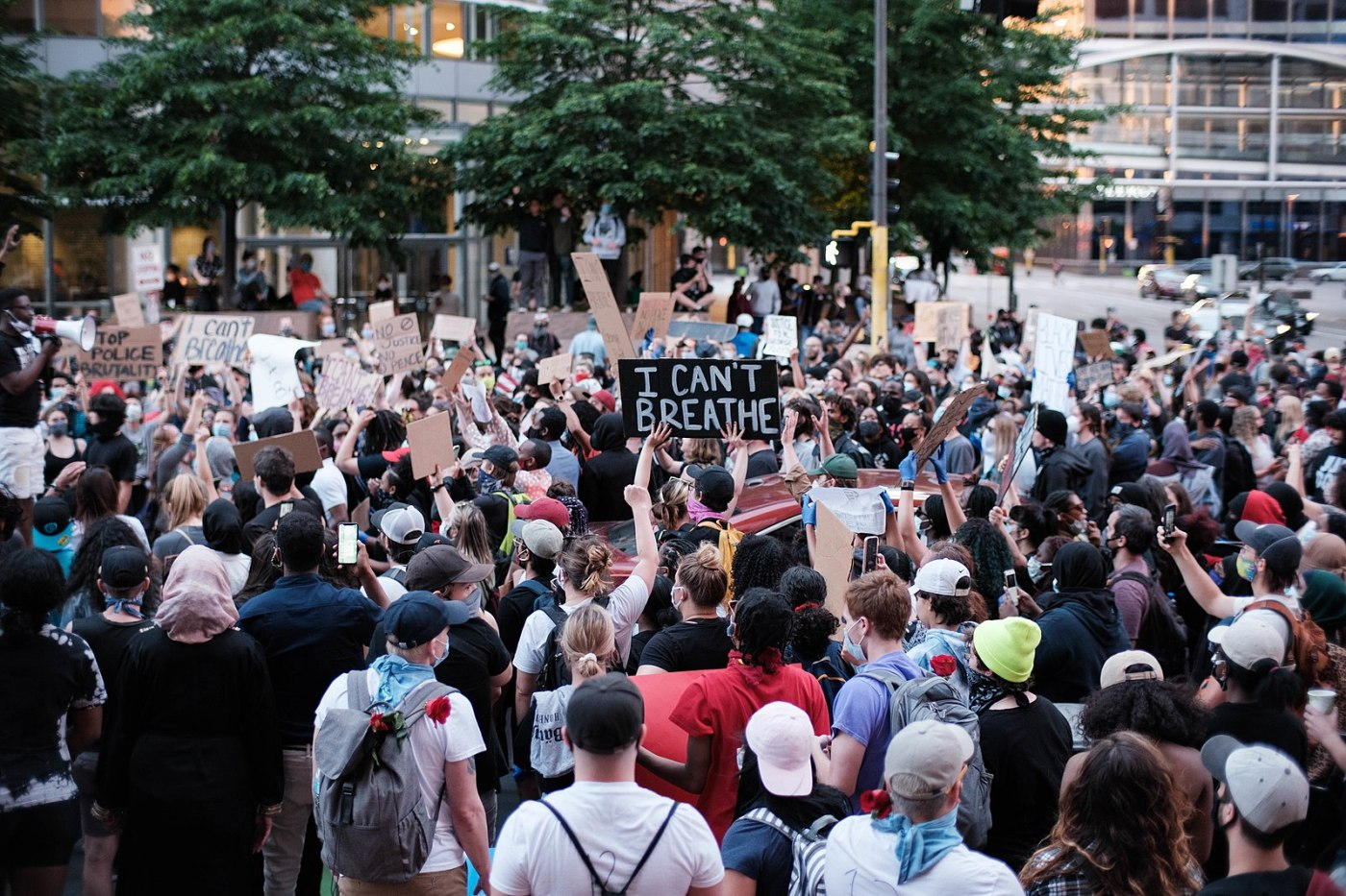 On May 28, 2020, in Minneapolis, a crowd protests the police murder of George Floyd. Image posted to Wikimedia Commons by Flickr user Dan Aasland.